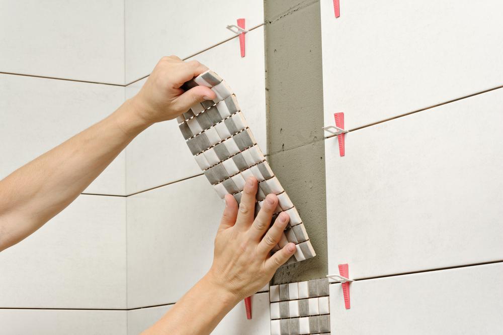 contractor renovates bathroom tile